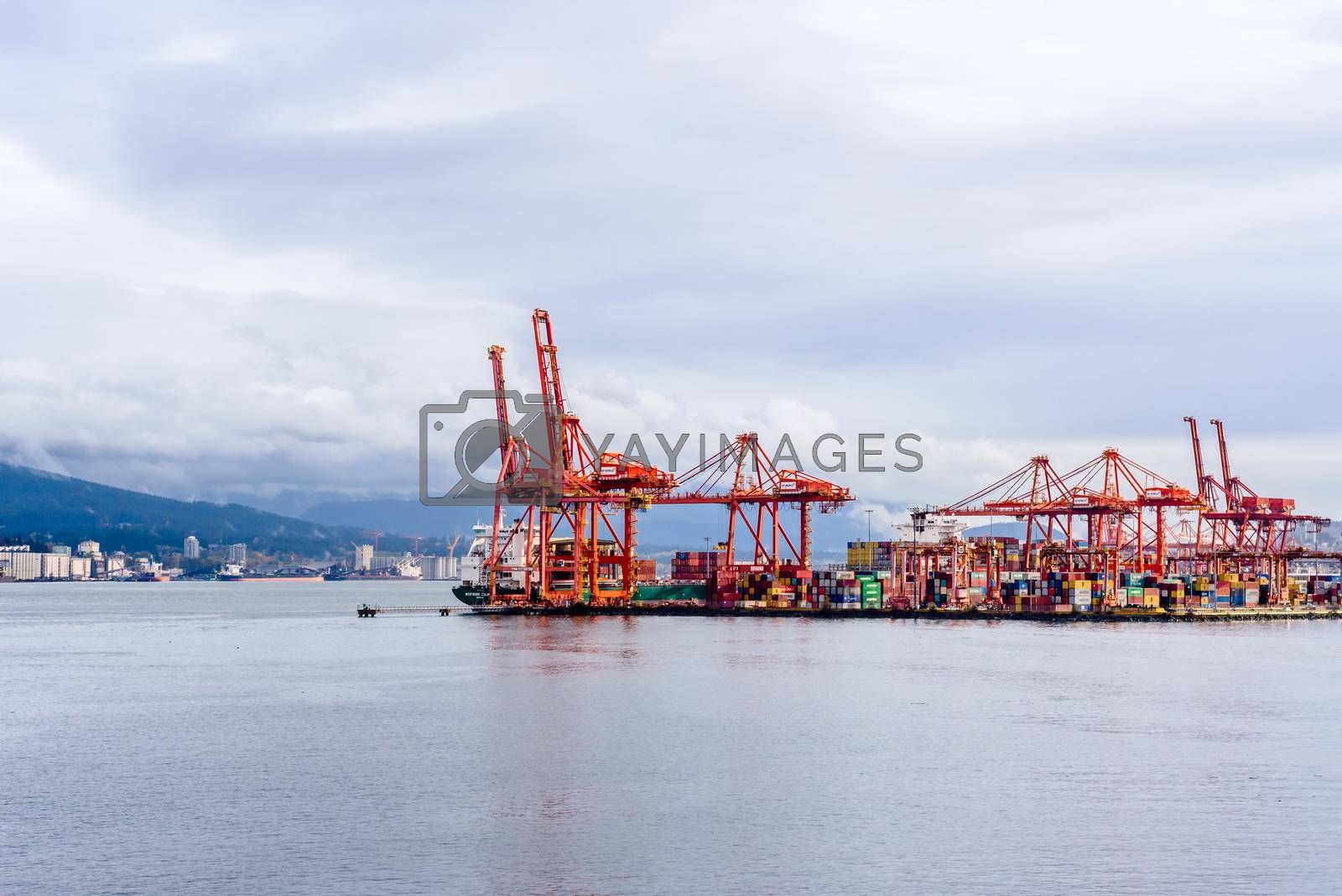 VANCOUVER, BC, CANADA - OCTOBER 28, 2018: Centennial Terminals is a major commercial dock with container cranes and heavy lift machinery.