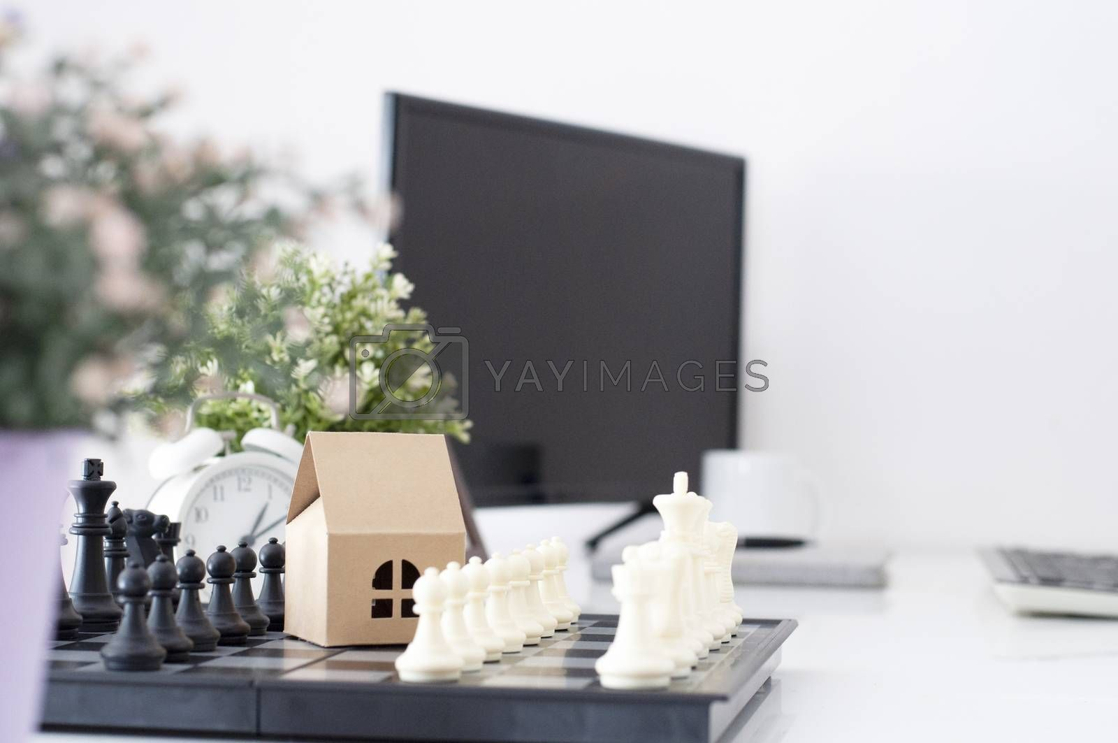 Home  sweet home. Financial business. Home loan. Real estate strategy. Home mock up on chess board. home Economic strategy on work table. home Financial business strategy.Real estate planning management.