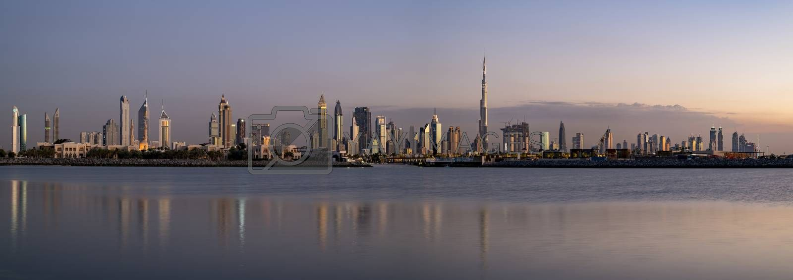 Panoramic view of Dubai Skyline at sunset with large space for text or large title, United Arab Emirates (UAE), Middle East