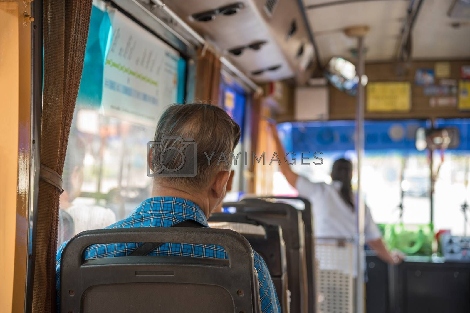 Bangkok, Thailand - March 25, 2017 : Unidentified people travel by bus in Bangkok. Buses are one of the most important public transport system in Bangkok.