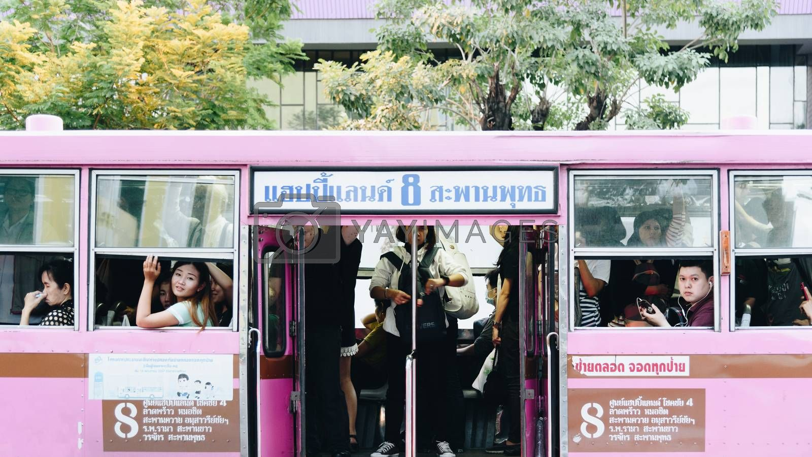 Bangkok, Thailand - May 9, 2017 : Unidentified people travel by bus in Bangkok. Buses are one of the most important public transport system in Bangkok.