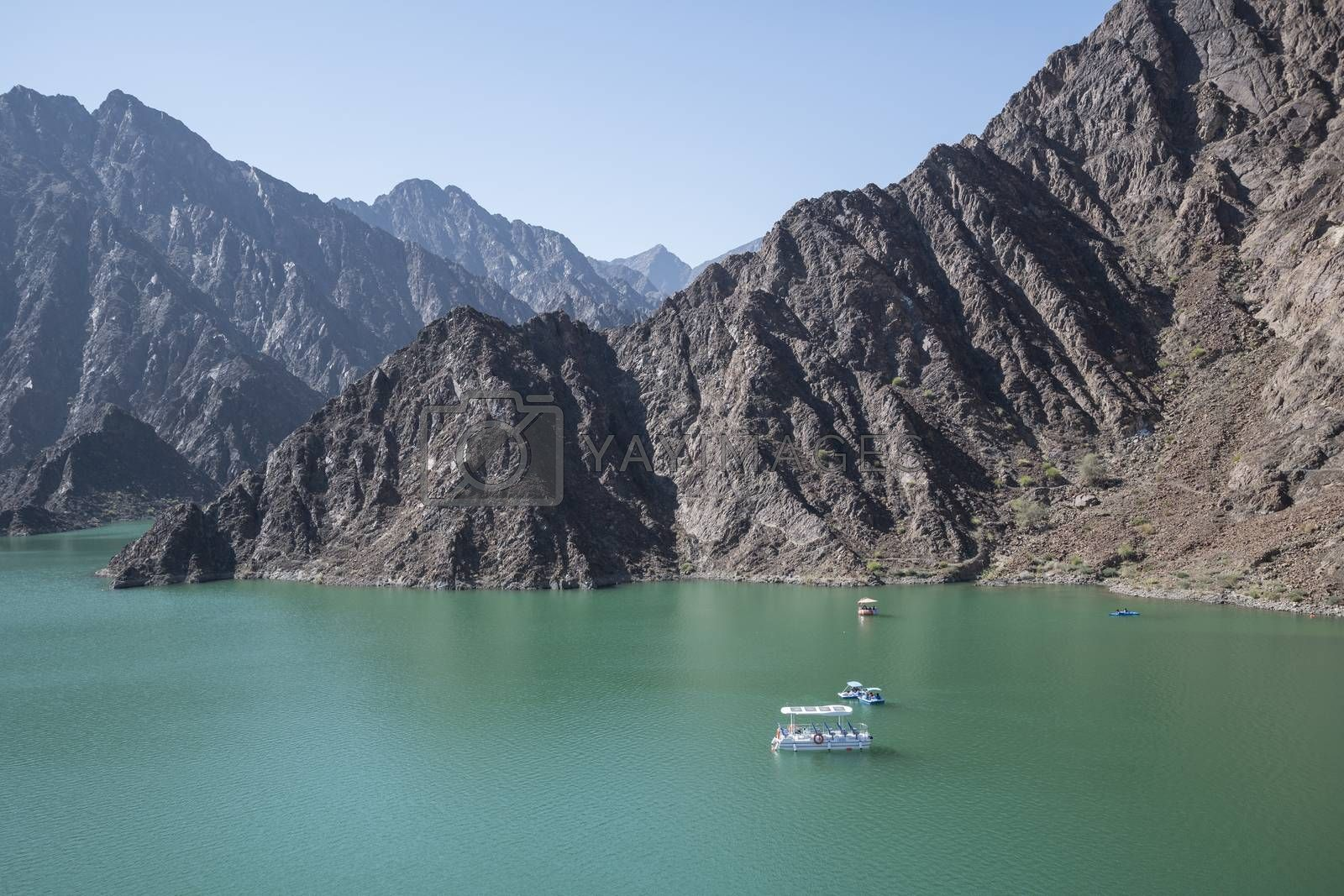 Hatta is the inland exclave of the emirate of Dubai in the UAE where people can enjoy kayaking and boating on the lake of Hatta Dam. United Arab Emirates