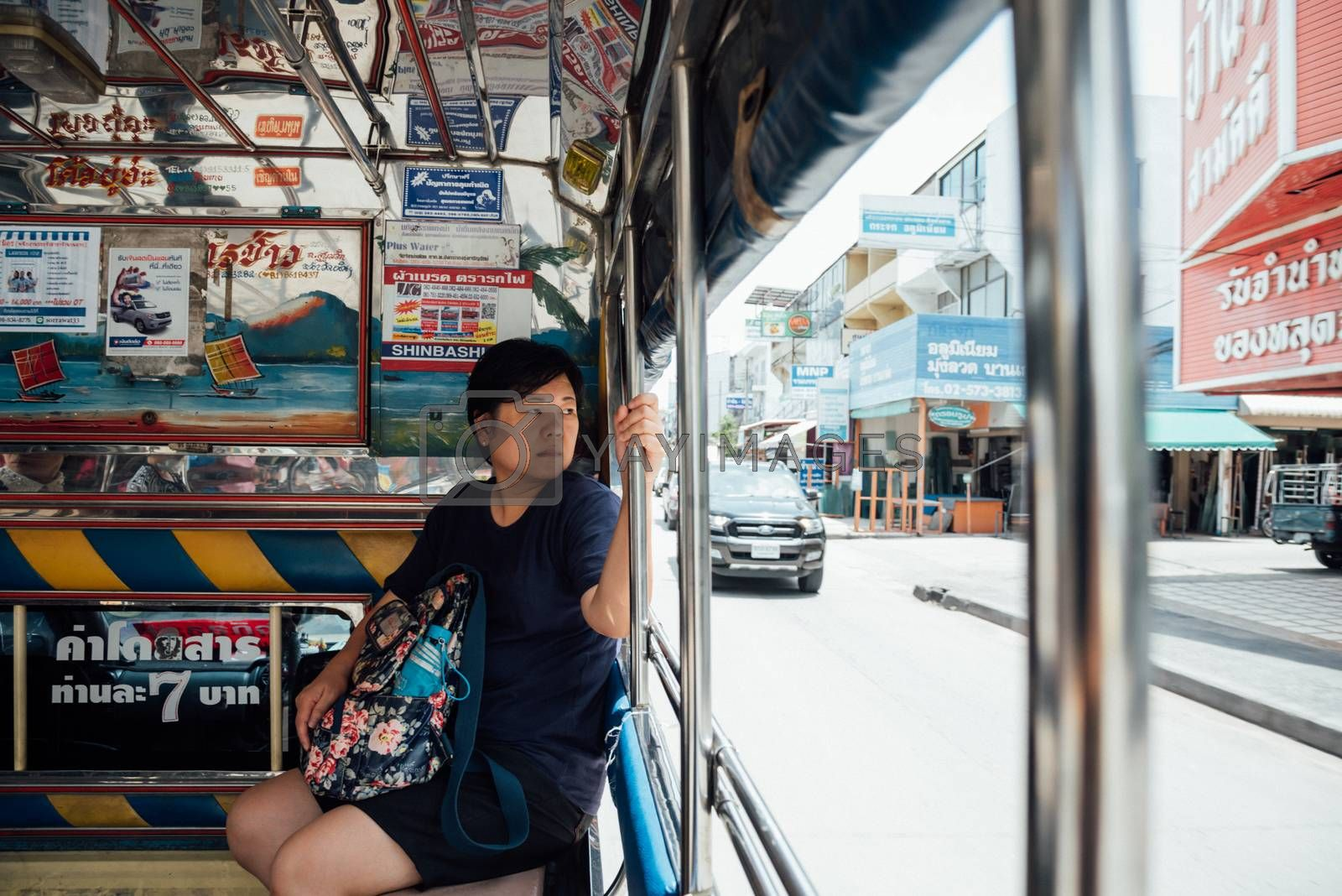 Asia women on a minibus car for a passenger travel by PongMoji