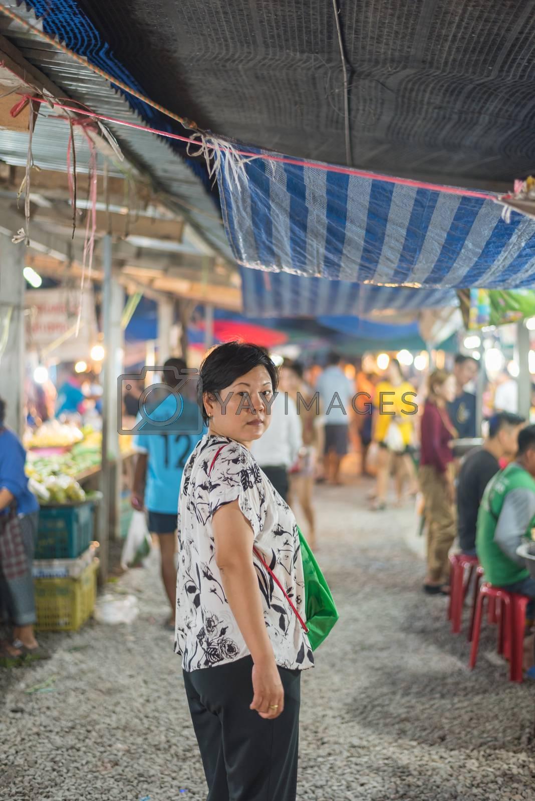 Woman shopping at Thai street food market by PongMoji