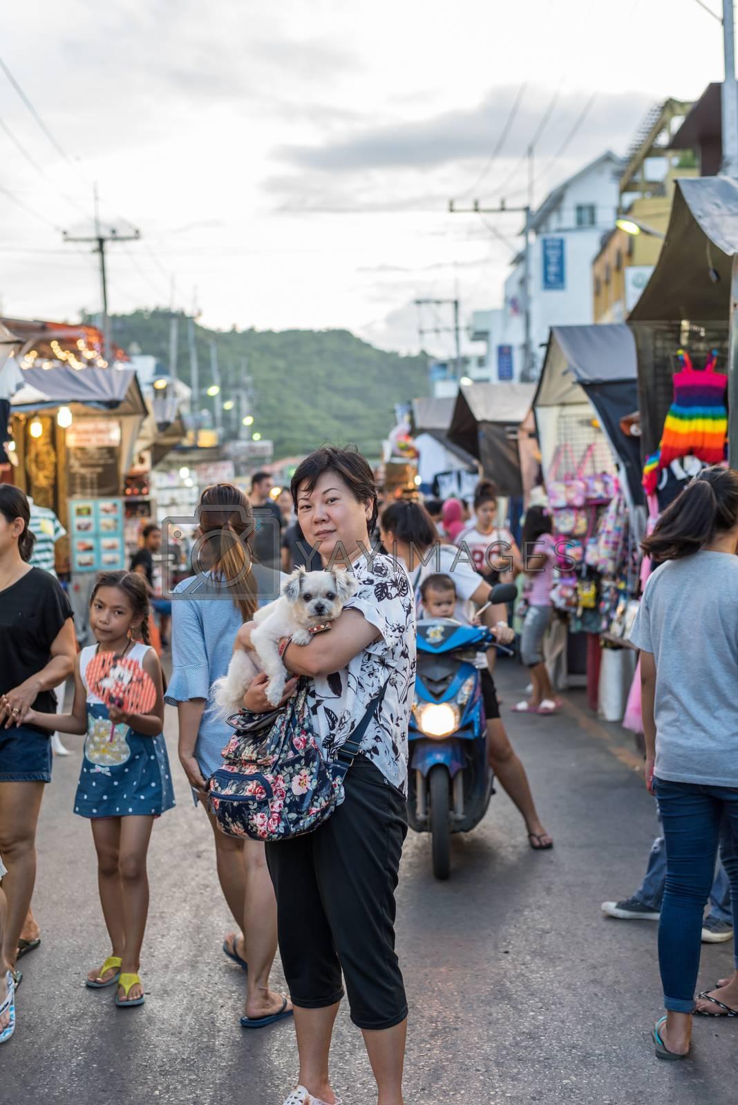 Hua Hin night market with woman and the dog by PongMoji