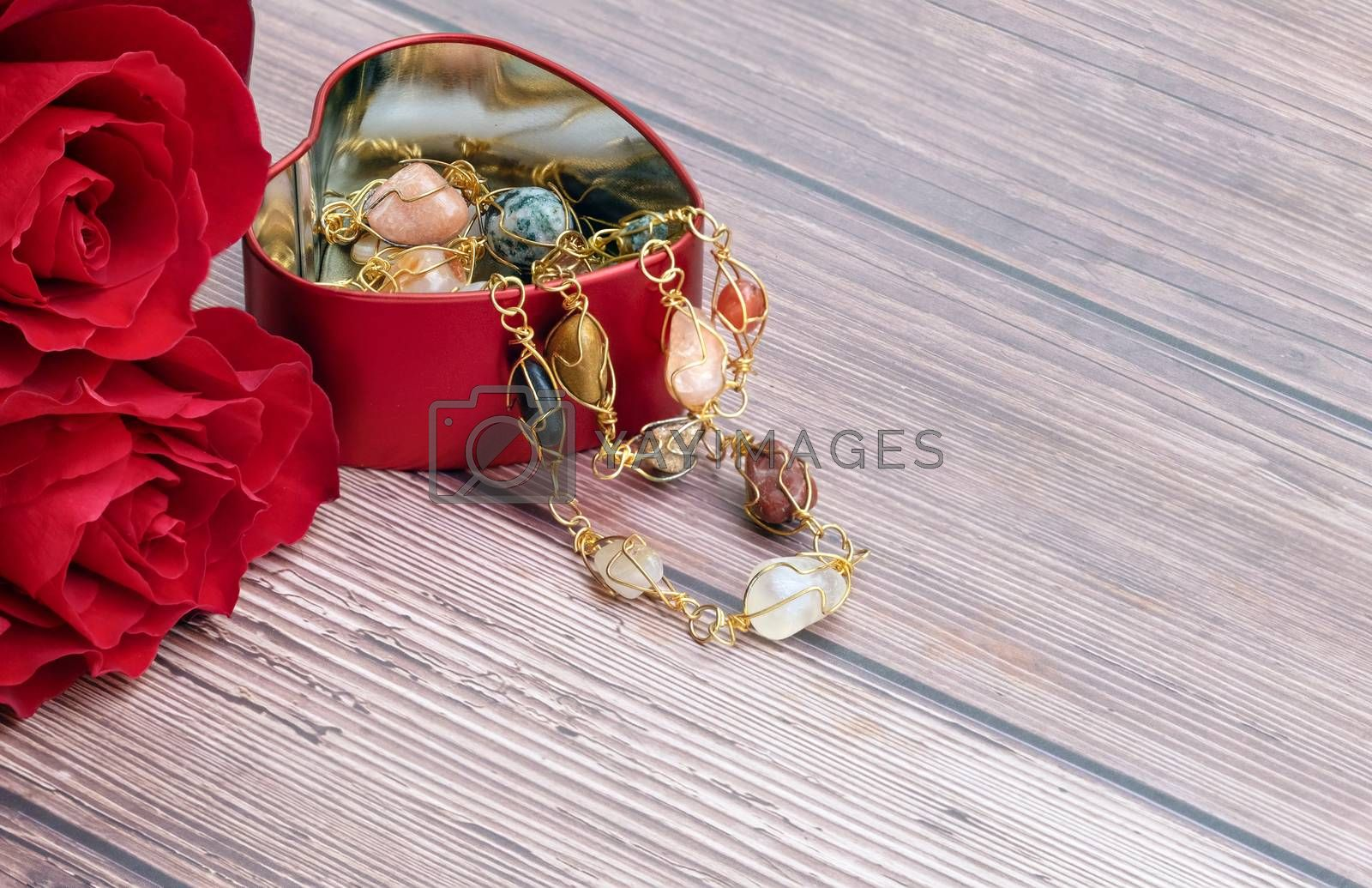 red roses and a heart-shaped jewelry container by Nawoot