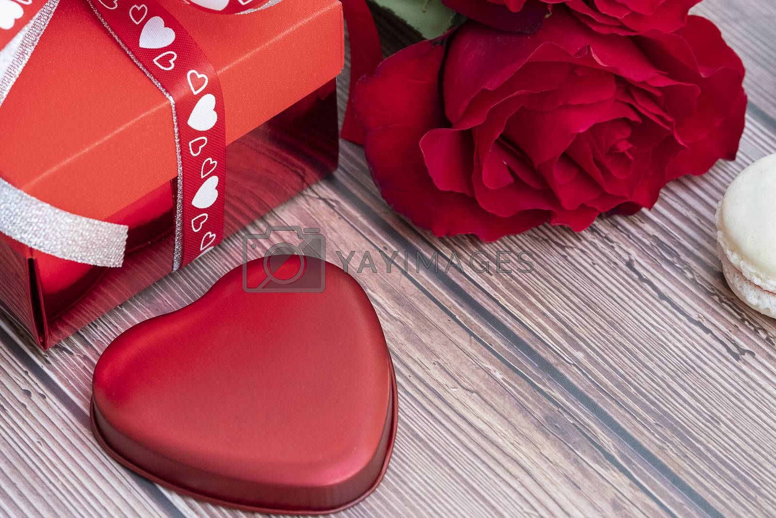 Present box, red rose, and a red heart-shaped metal piece by Nawoot