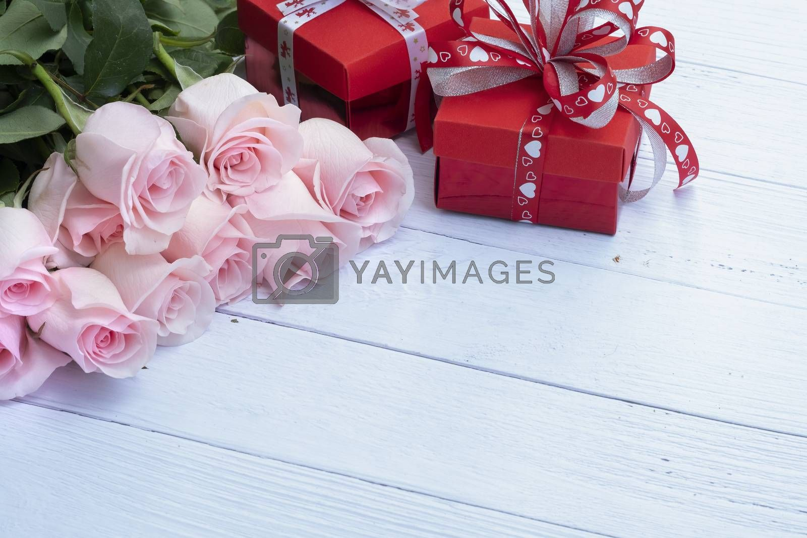 Beautiful bouquet of pink roses and red present boxes  by Nawoot