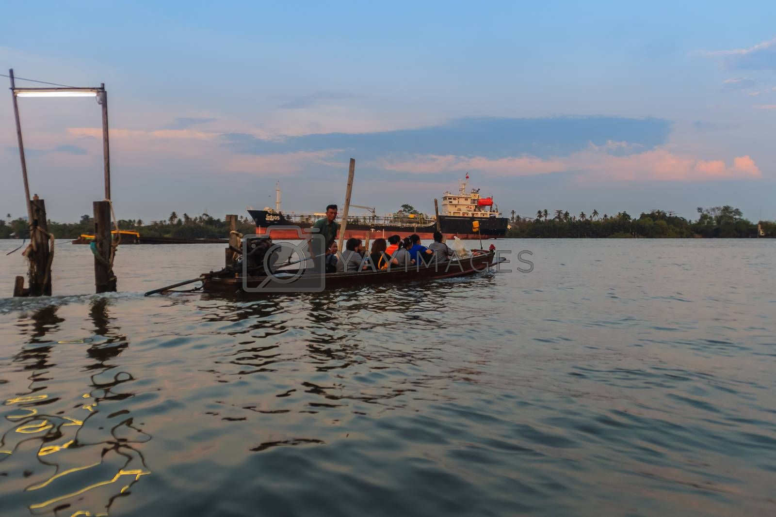Bangkok, Thailand - March 14, 2017: Slow lifestyle of villagers use a small boat service across the Chao Phraya river at Bang Krachao district pier.