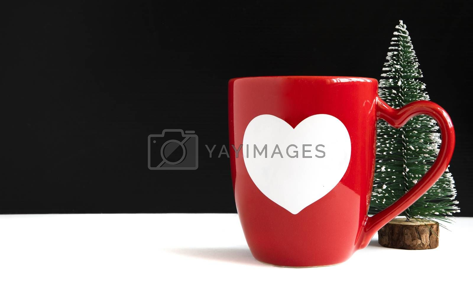 A mug and a miniature Christmas tree by Nawoot