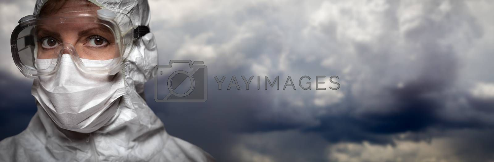 Doctor or Nurse Wearing Personal Protective Equipment Over Stormy Clouds Banner.