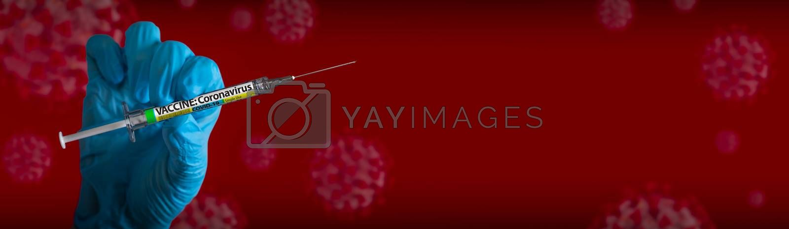 Doctor or Nurse Wearing Surgical Glove Holding Medical Syringe with Coronavirus COVID-19 Vaccine Label Banner of Cells.