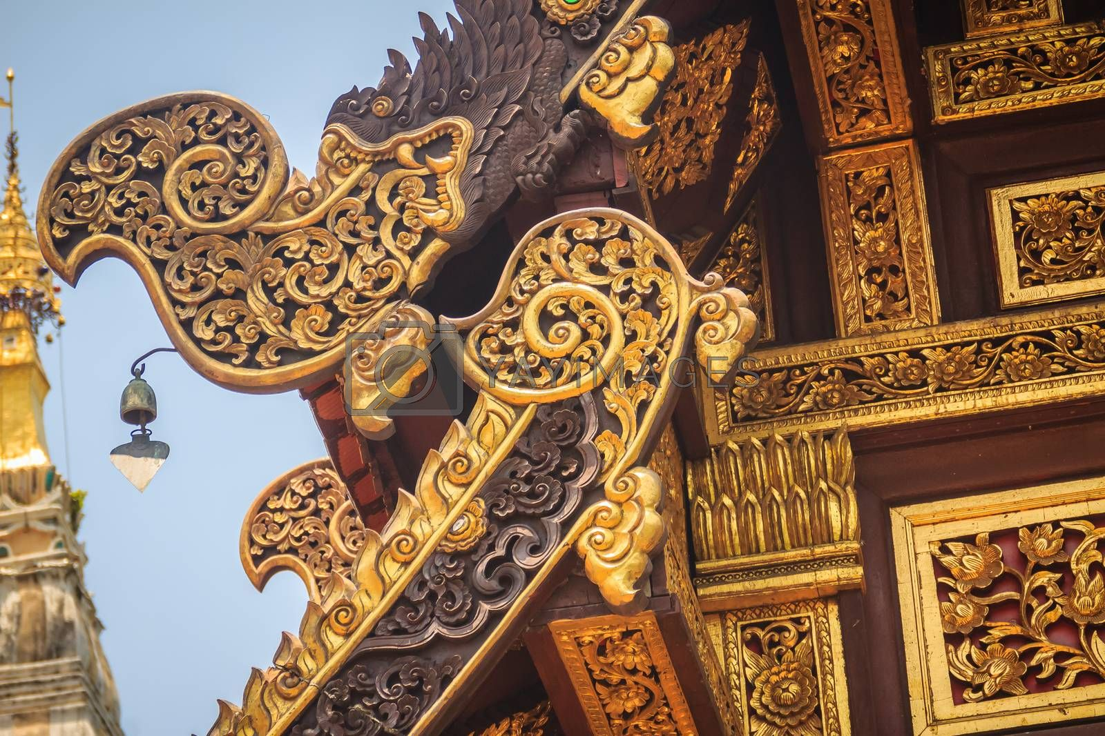 Beautiful craved naga pattern on the rafter and gable of the Thai's northern style church at Wat Chedi Liam, one of the ancient temple in the Wiang Kum Kam archaeological area, Chiang Mai, Thailand.