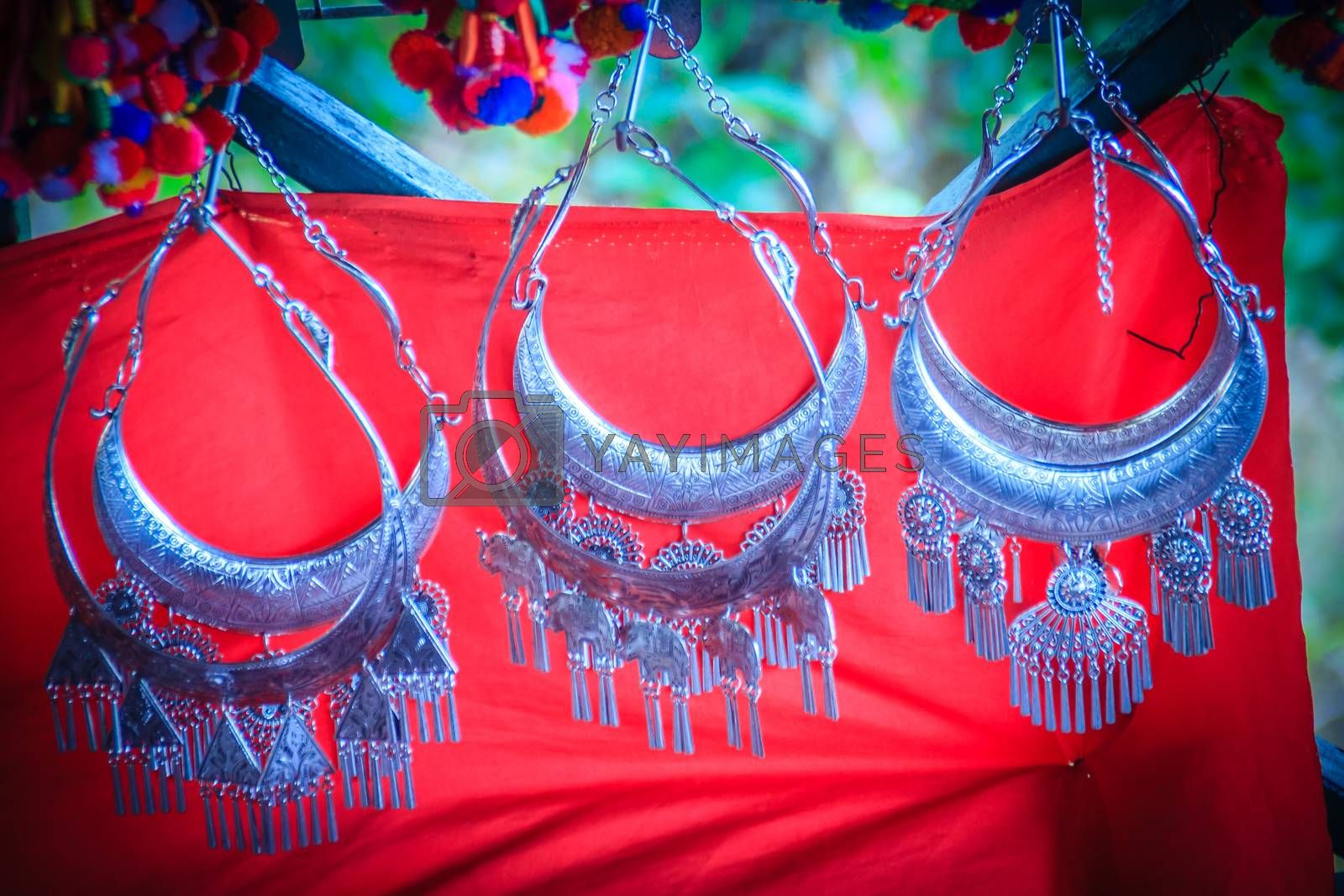 Beautiful traditional Hmong hill tribe silver ornaments for sale as souvenir at Doi Pui's Hmong ethnic hill-tribe village, Chiang Mai, Thailand.