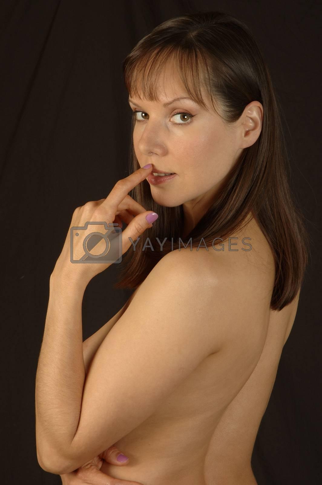 A beautiful brunette woman pressing finger on top lip