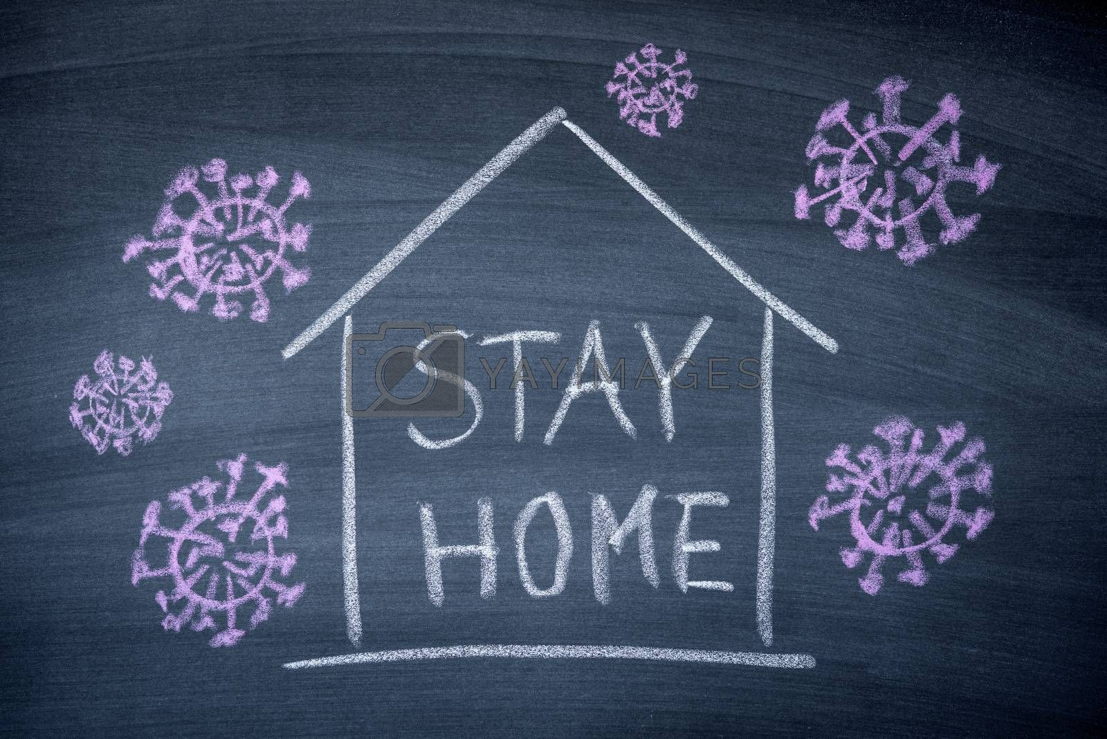 Stay at Home surrounded by Corona virus sign write on black chalkboard , prevent COVID-19 corona virus  spreading