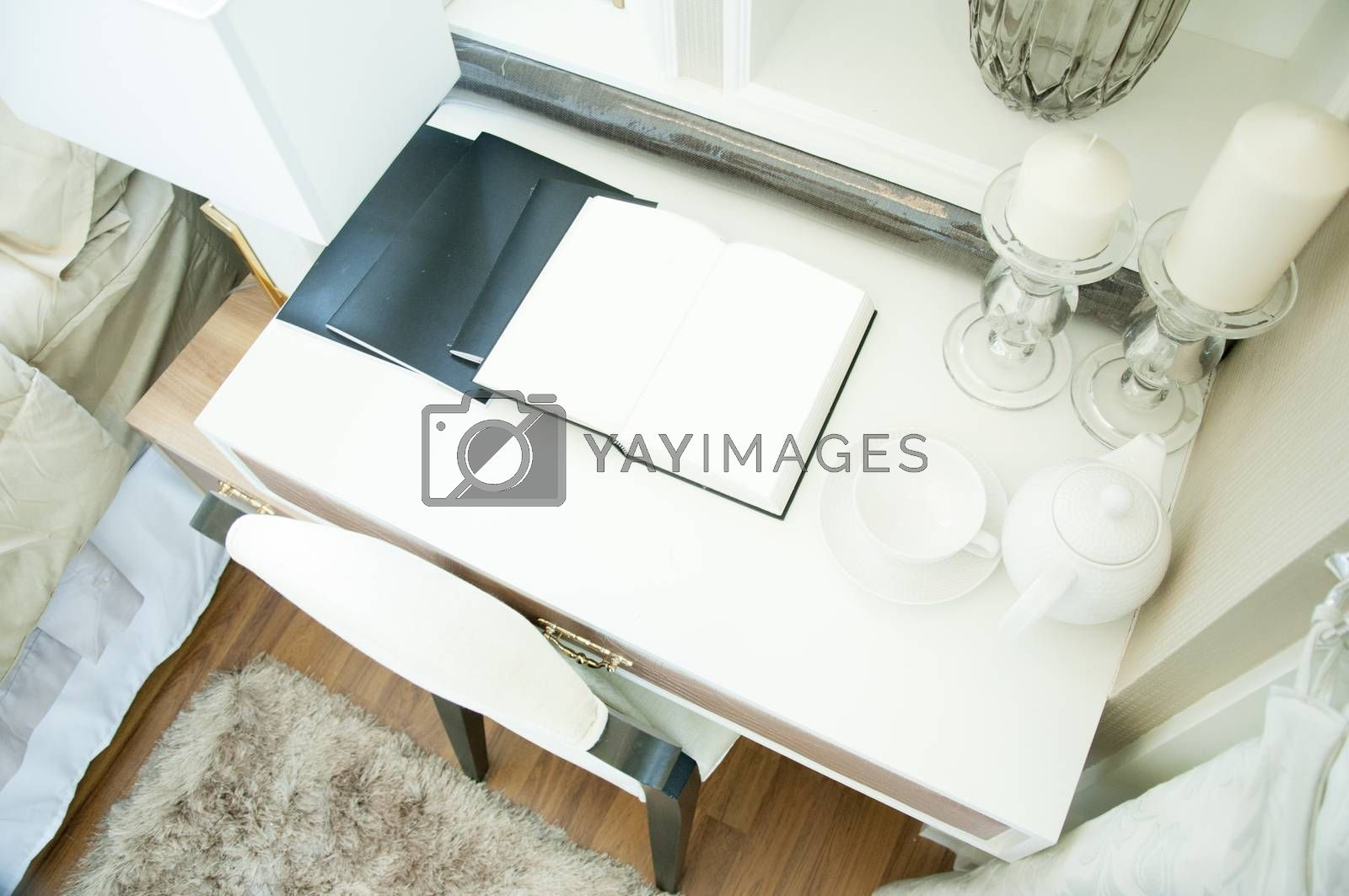 white book page open on the table in luxury bedroom. by Kingsman911