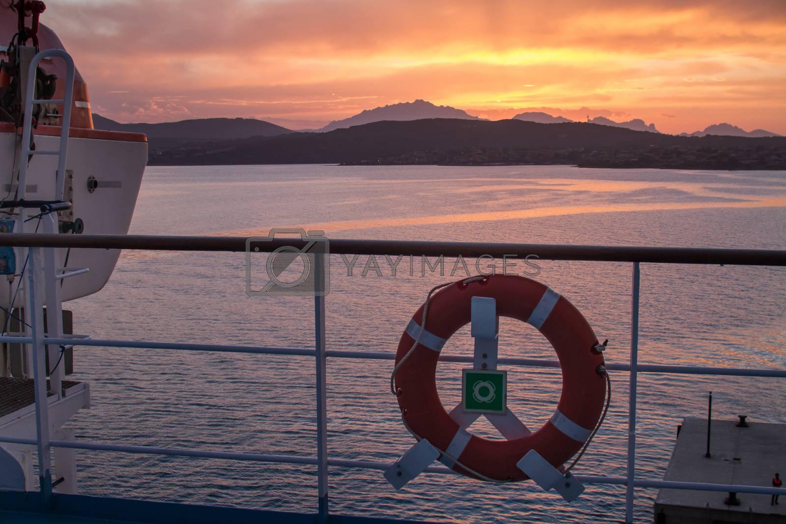 Sunrise on the Sardinian sea coast with intense orange color see by robbyfontanesi
