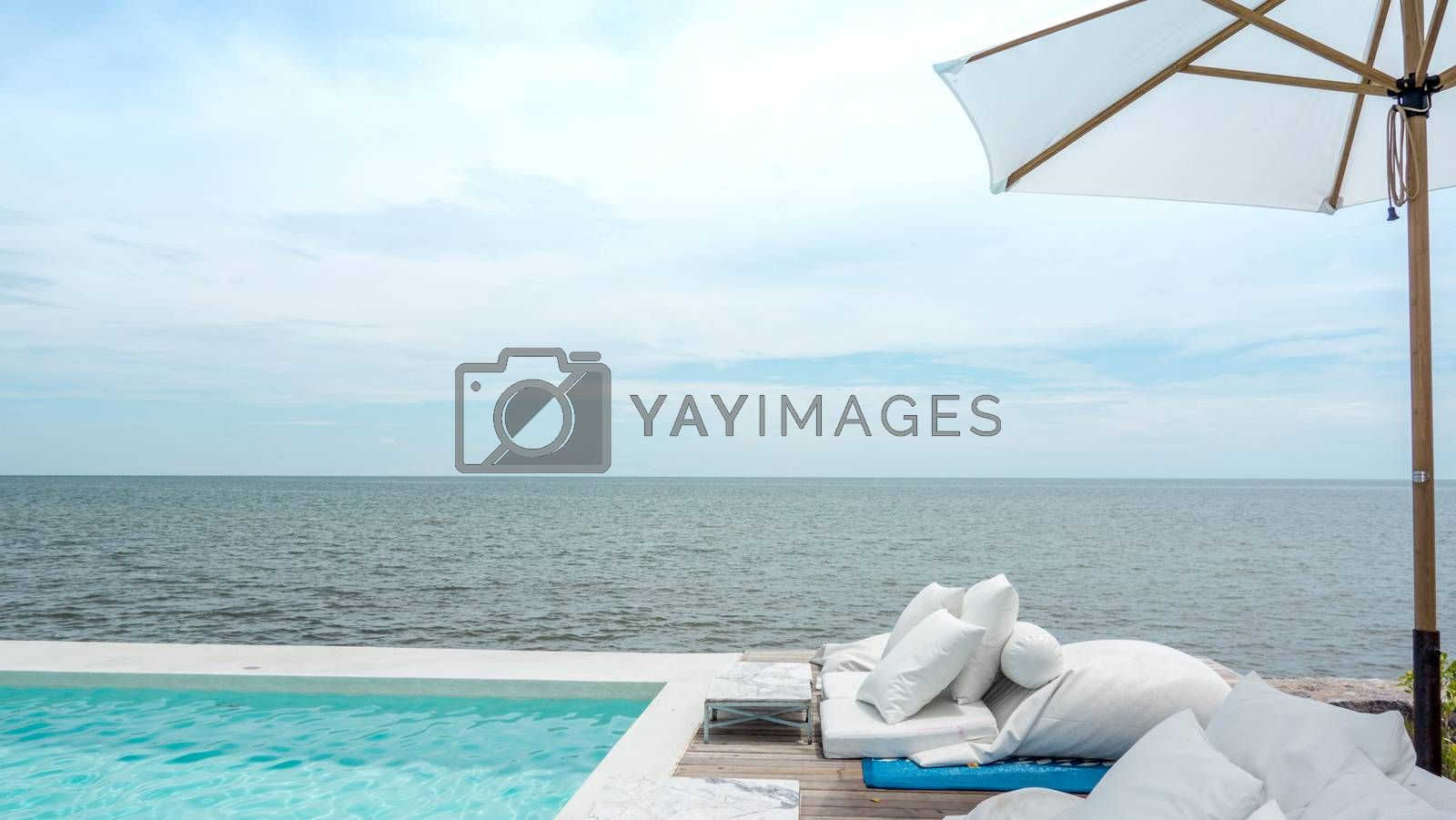 Luxury swimming pool and blue water at the resort with beautiful by Kingsman911