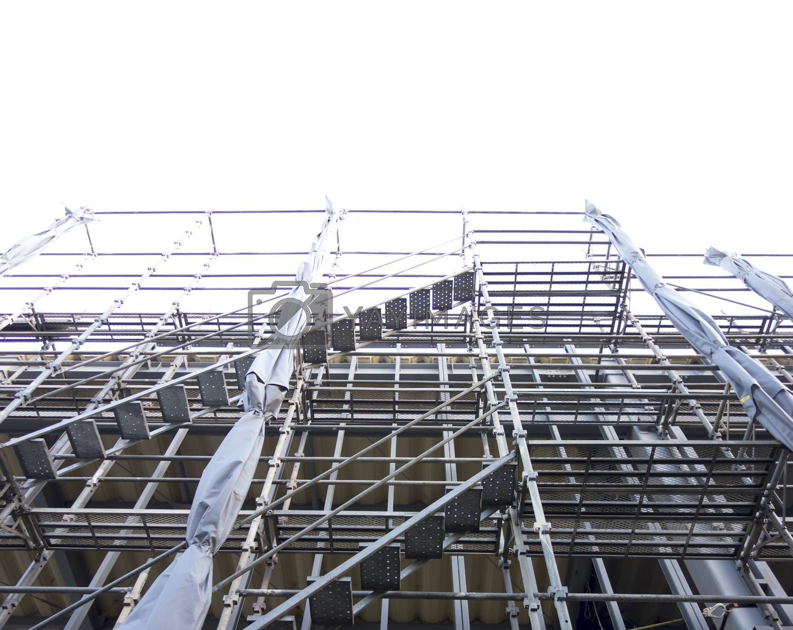 Scaffolding around the building for the construction. Construction building with Scaffolding around the building