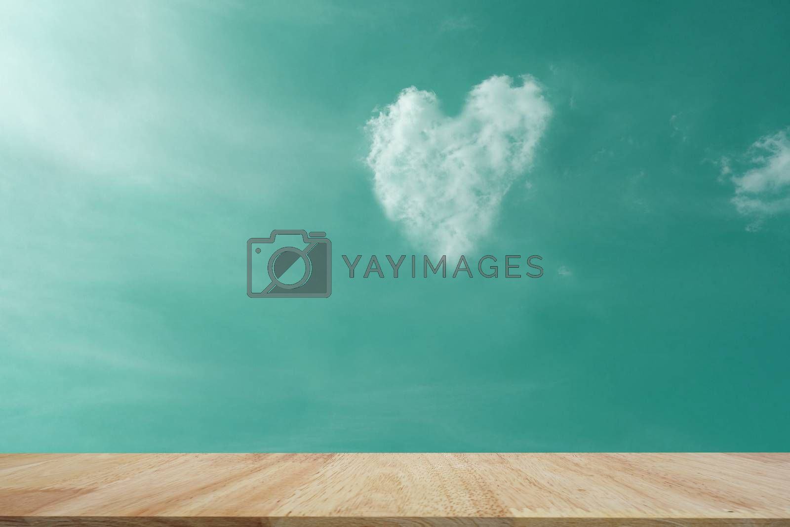 table top on Abstact color sky and beautiful clound for blackground. Heart  symbal of clound