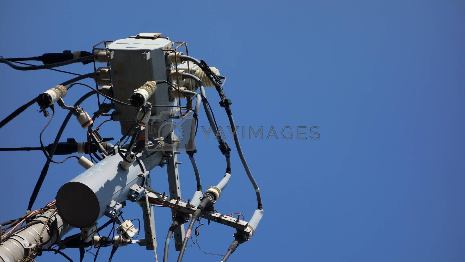 Close up The electric pole in Tokyo, Japan and electric transformer with clear blue sky