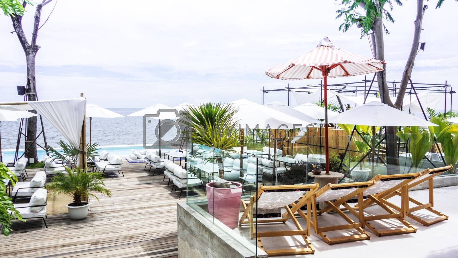 Chaise lounge, umbrella and private swimming pool near luxury vi by Kingsman911