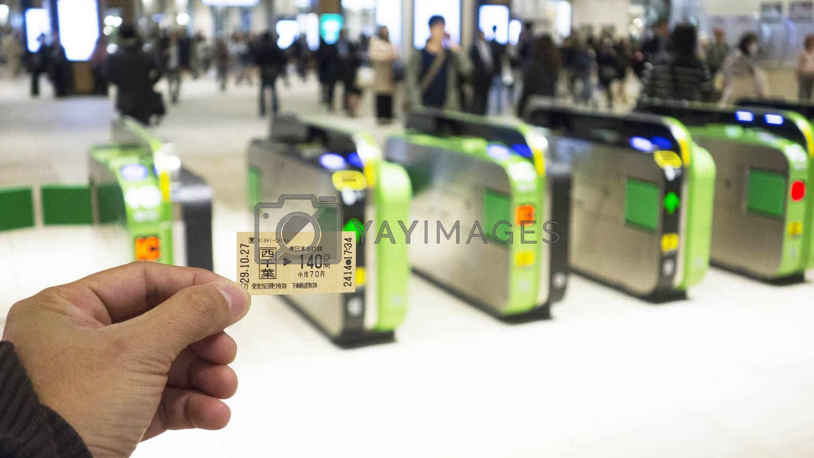 Chiba Japan 29 October 2017 - The tourist use ticket of train at at railway station gate.