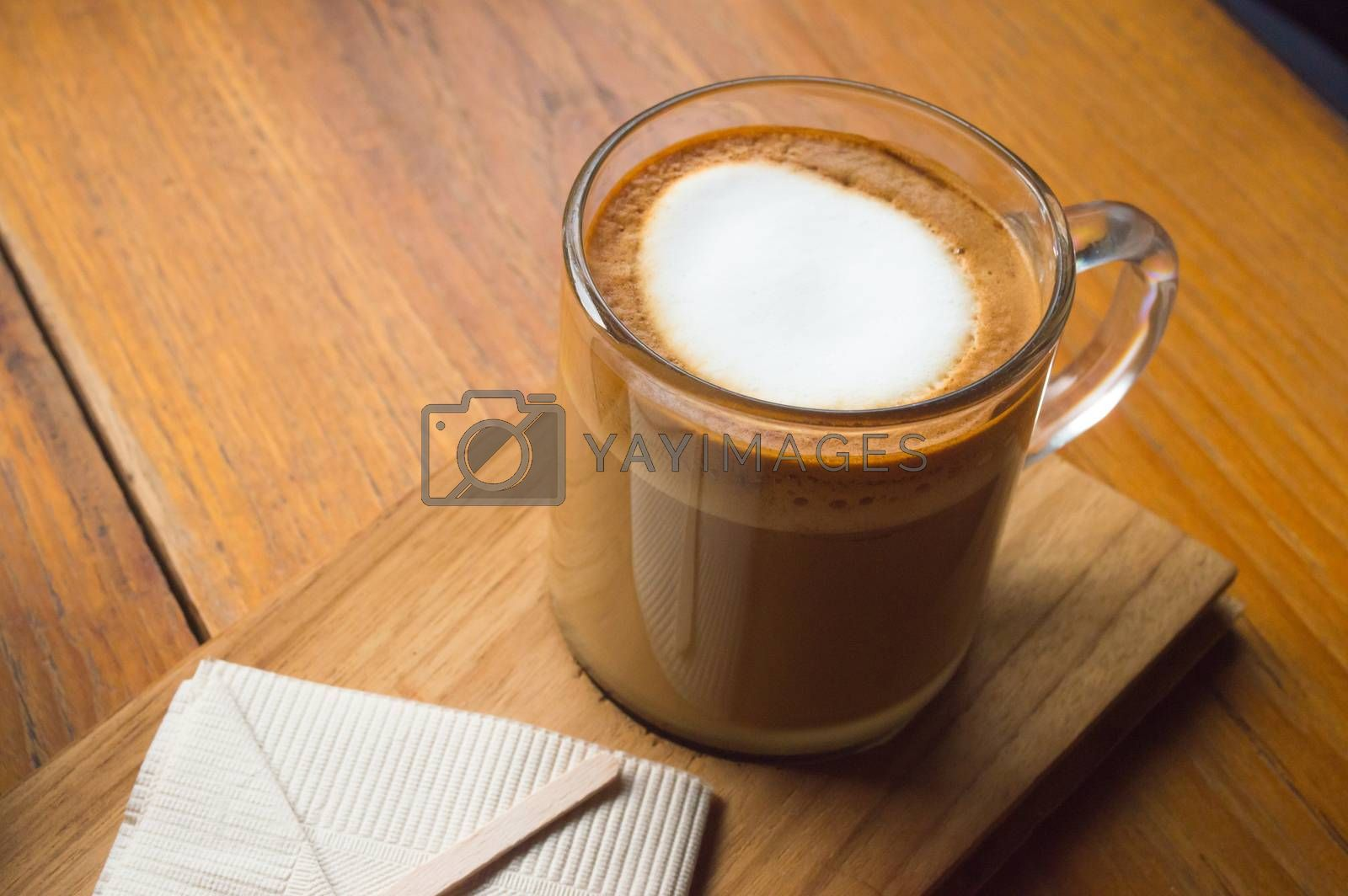 Glass of coffee on the wooden table