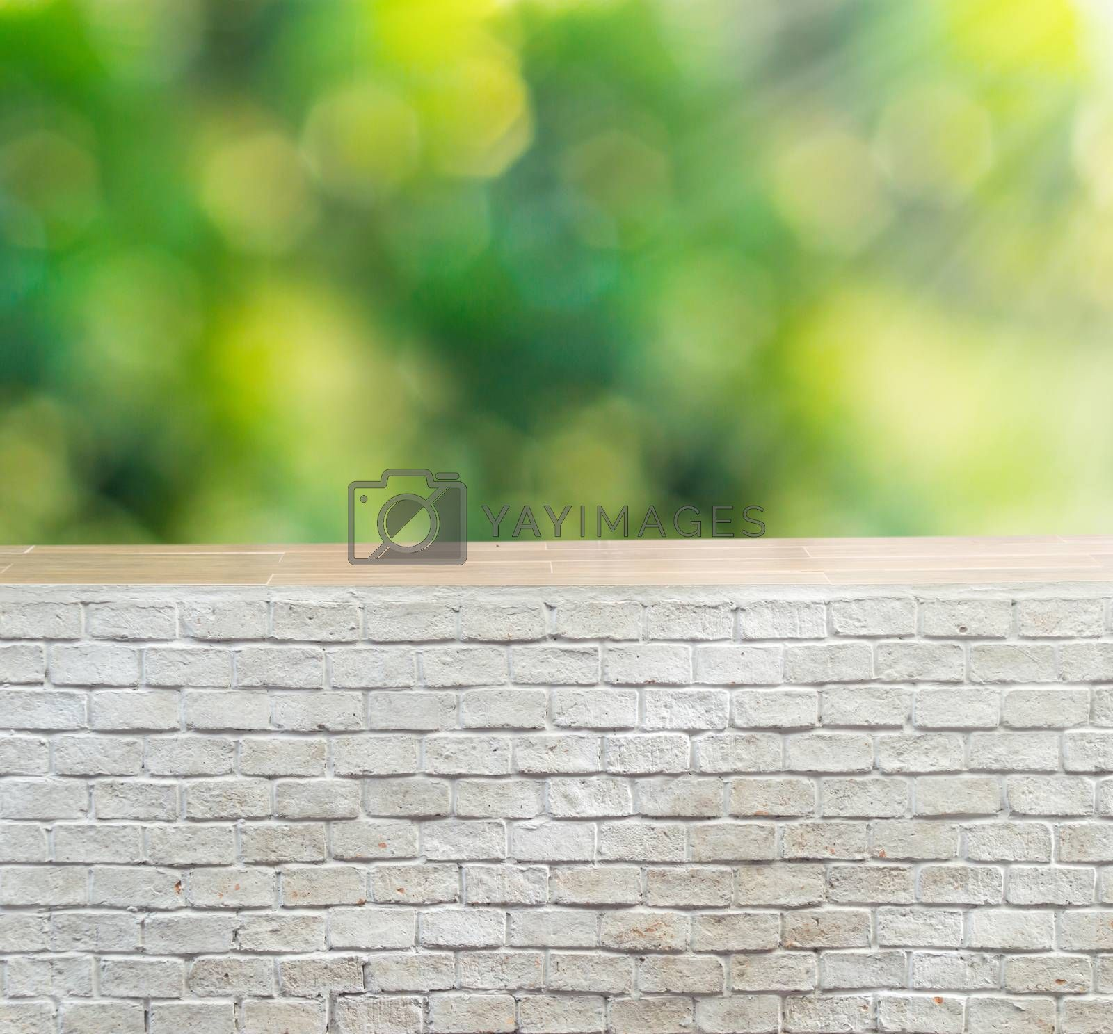 Empty brick wall with foliage bokeh background, Ready for product display present