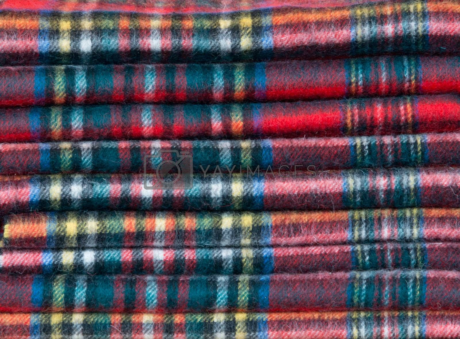 A pile of tartan scarves