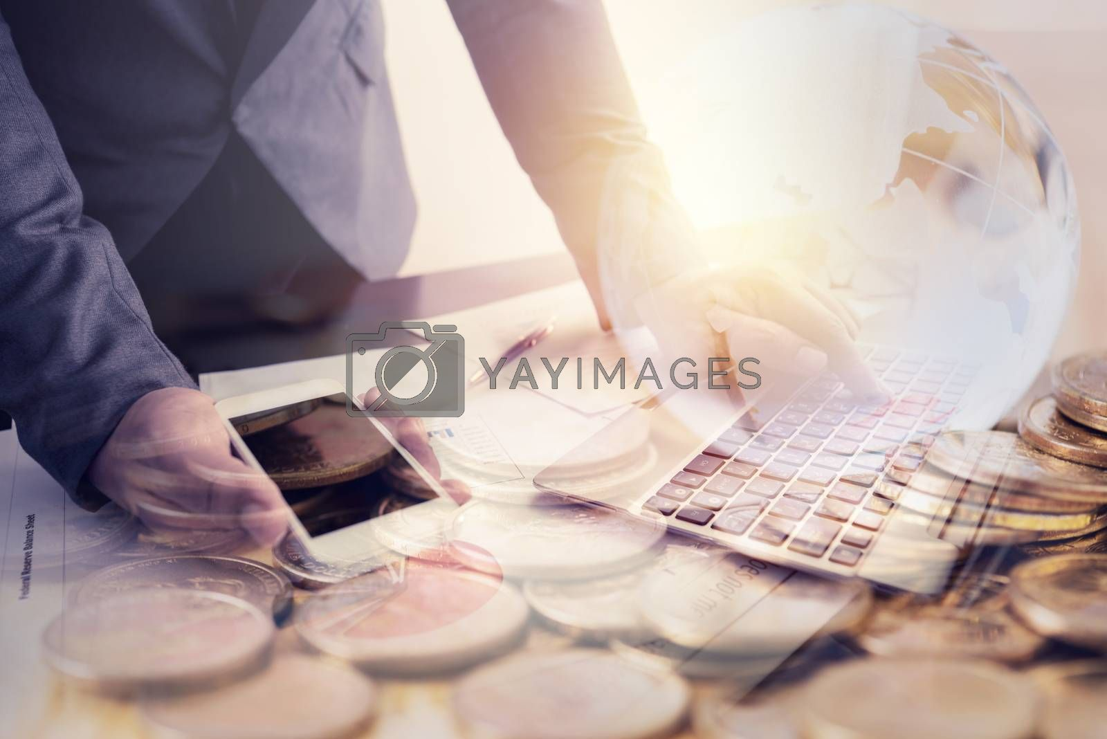 businessman working with smart phone and laptop on the work tabl by Lerttanapunyaporn