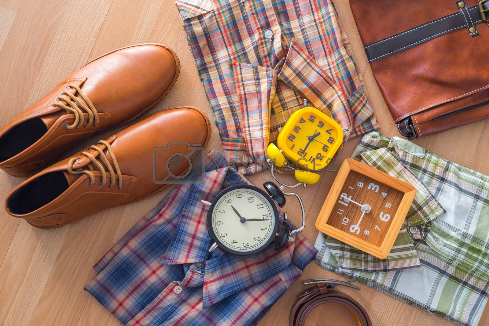 flat lay of men's casual fashion on brown wooden floor background