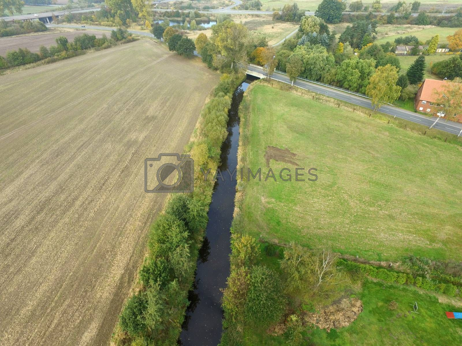 Aerial photograph of a straightened unnatural stream between fie by geogif