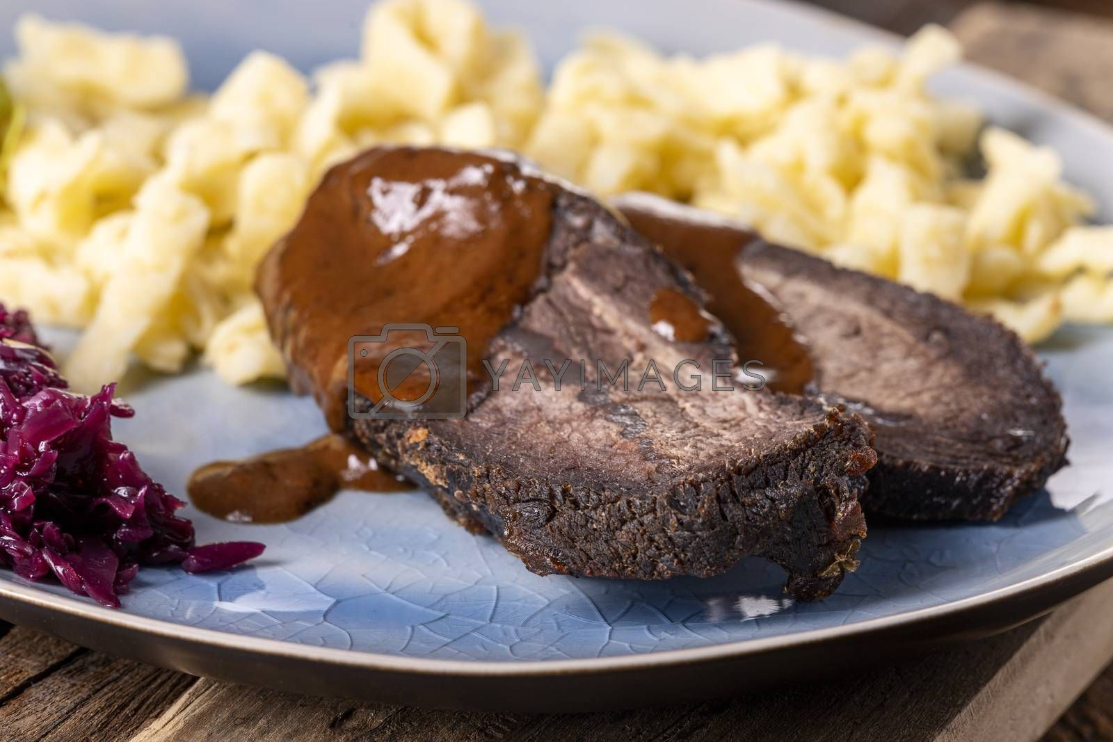 closeup of a german sauerbraten with dumplings