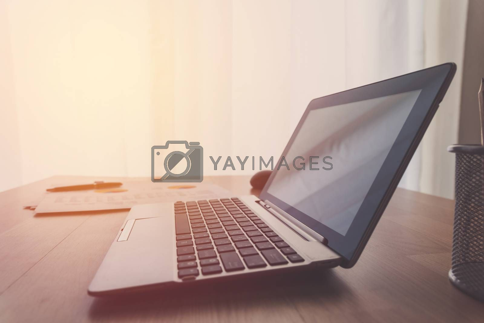 laptop on working table by Lerttanapunyaporn