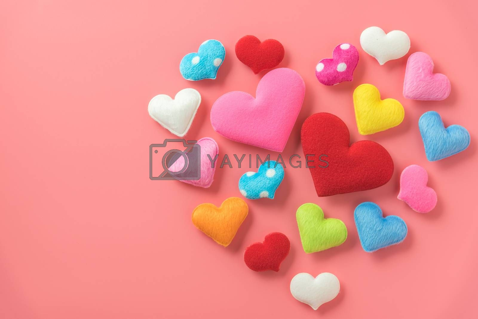 mini heart in heart shape on pink background by Lerttanapunyaporn