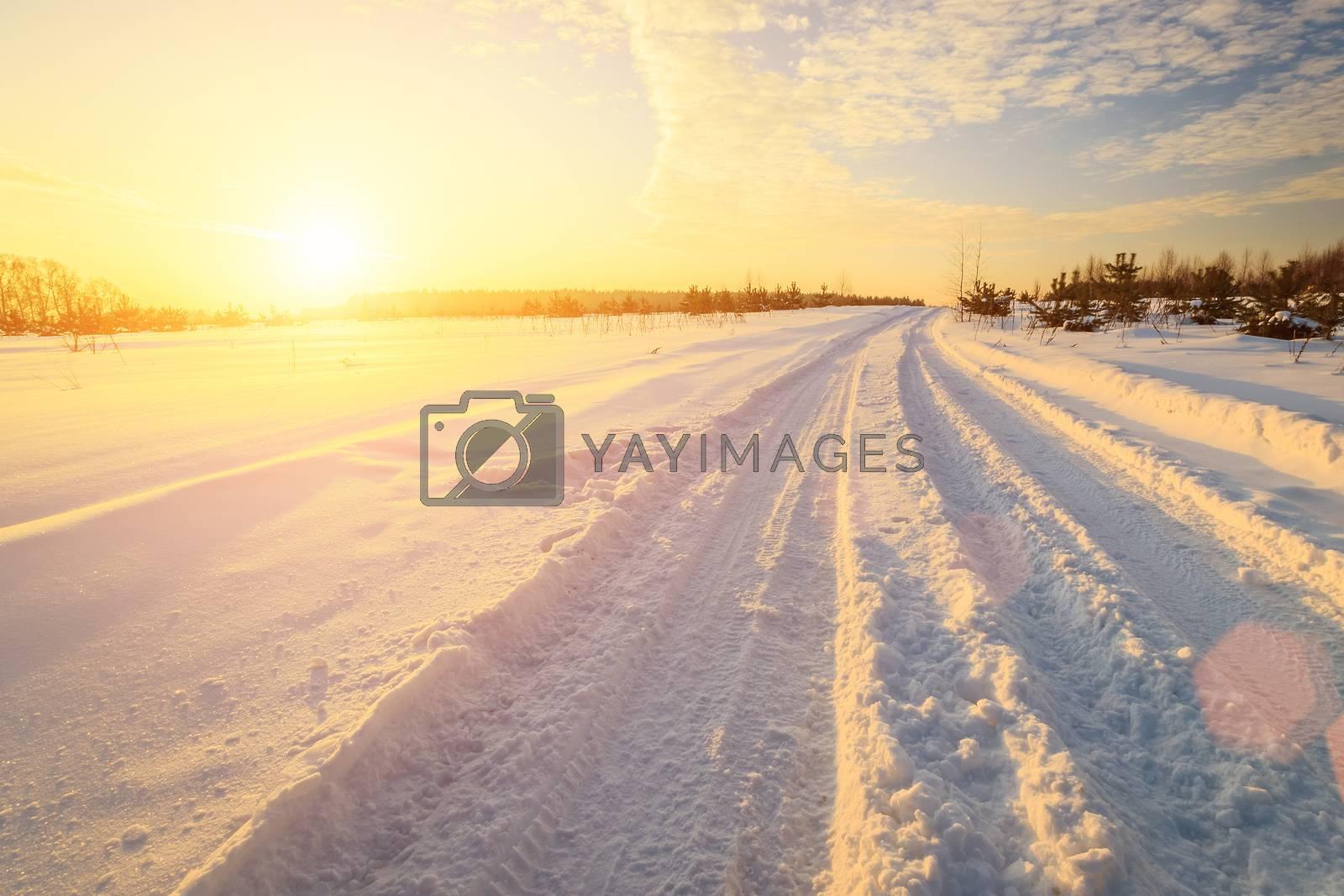 Sunset in a winter field. by Eugene Yemelyanov