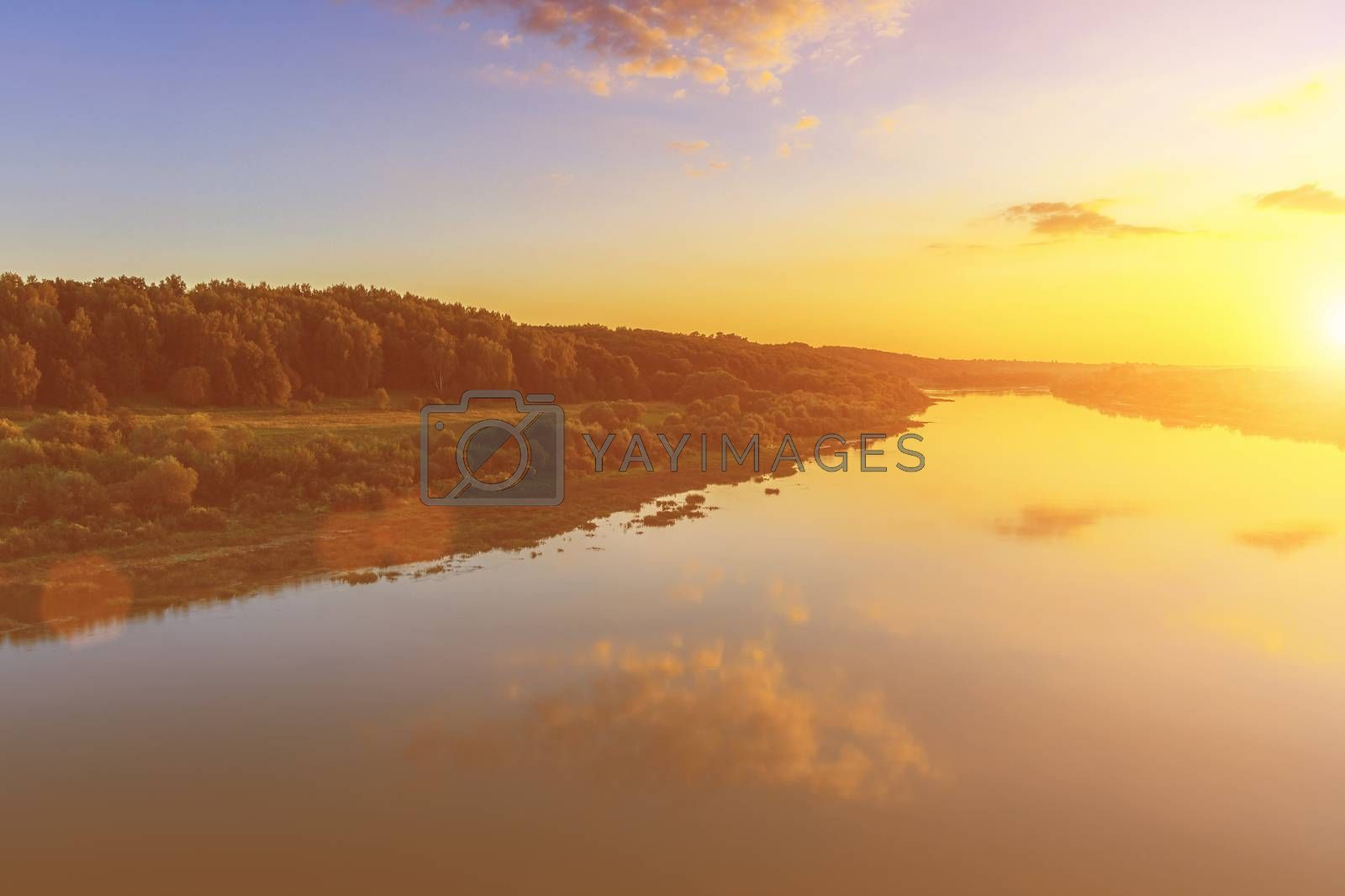 Sunset or sunrise on the river or lake. by Eugene Yemelyanov