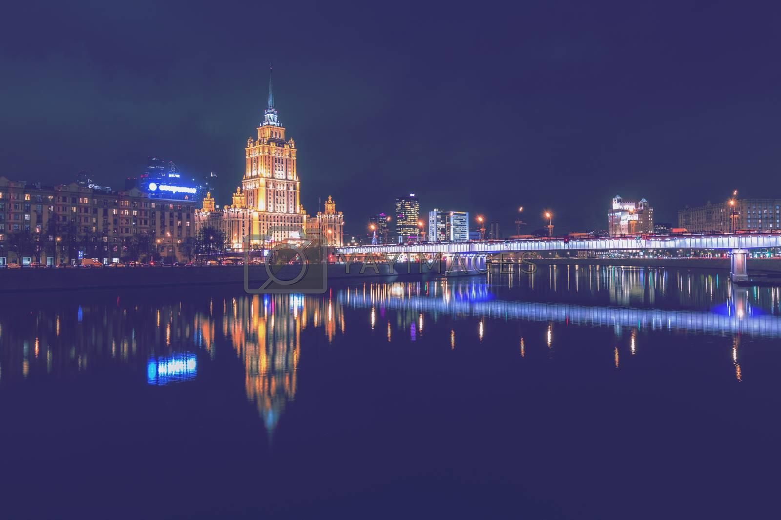 Moving car with blur light through twilight city. by Eugene Yemelyanov