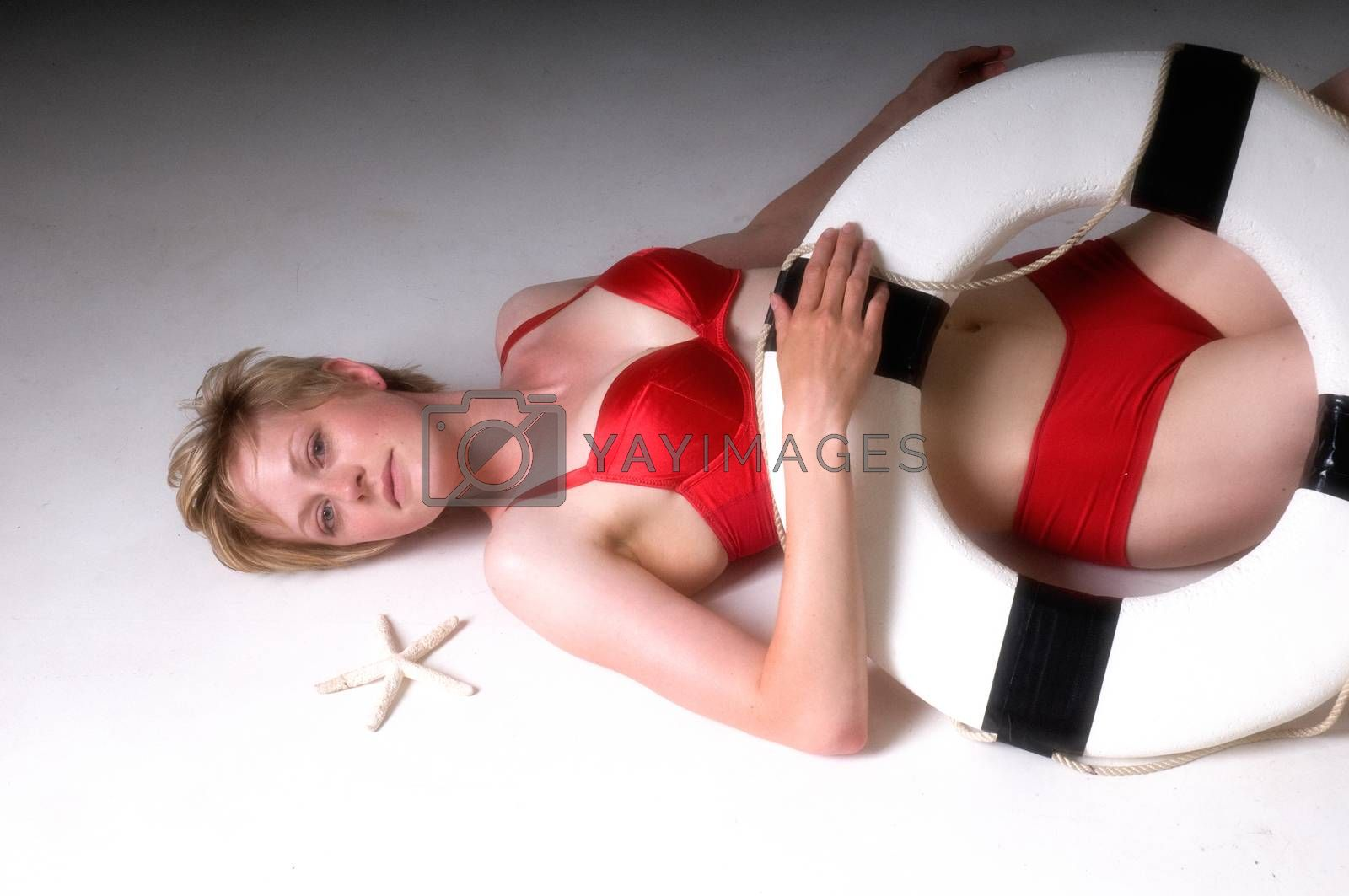 Attractive Young Blonde Woman in Bikini with Lifebouy Ring