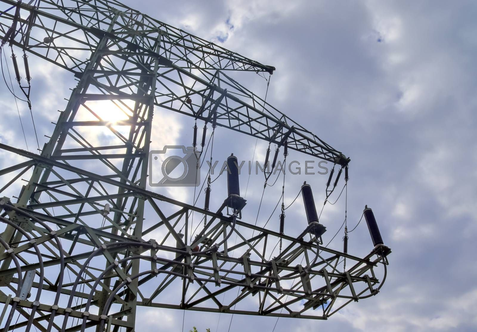 Close up view on a big power pylon transporting electricity in a by MP_foto71