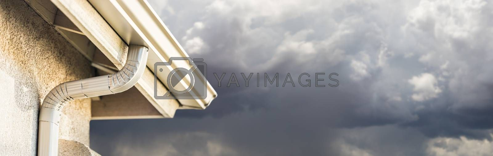 House with New Seamless Aluminum Rain Gutters With Storm Background Banner. by Feverpitched