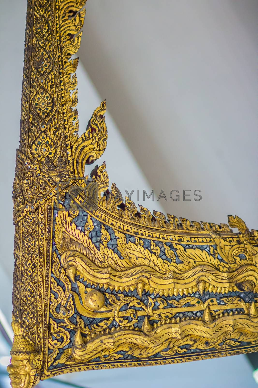 Beautiful traditional Thai style craving patterned of Samatthachai royal barge. Monster head craved pattern in thai royal barge.