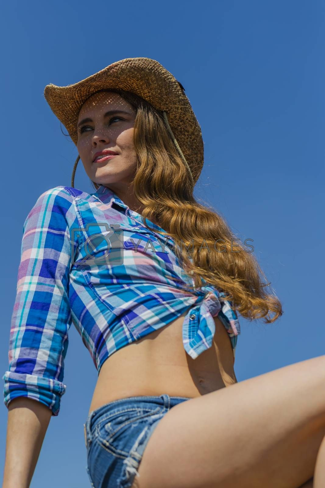 A Lovely Hispanic Brunette Model Poses Outdoors On A Mexican Ranch by actionsports