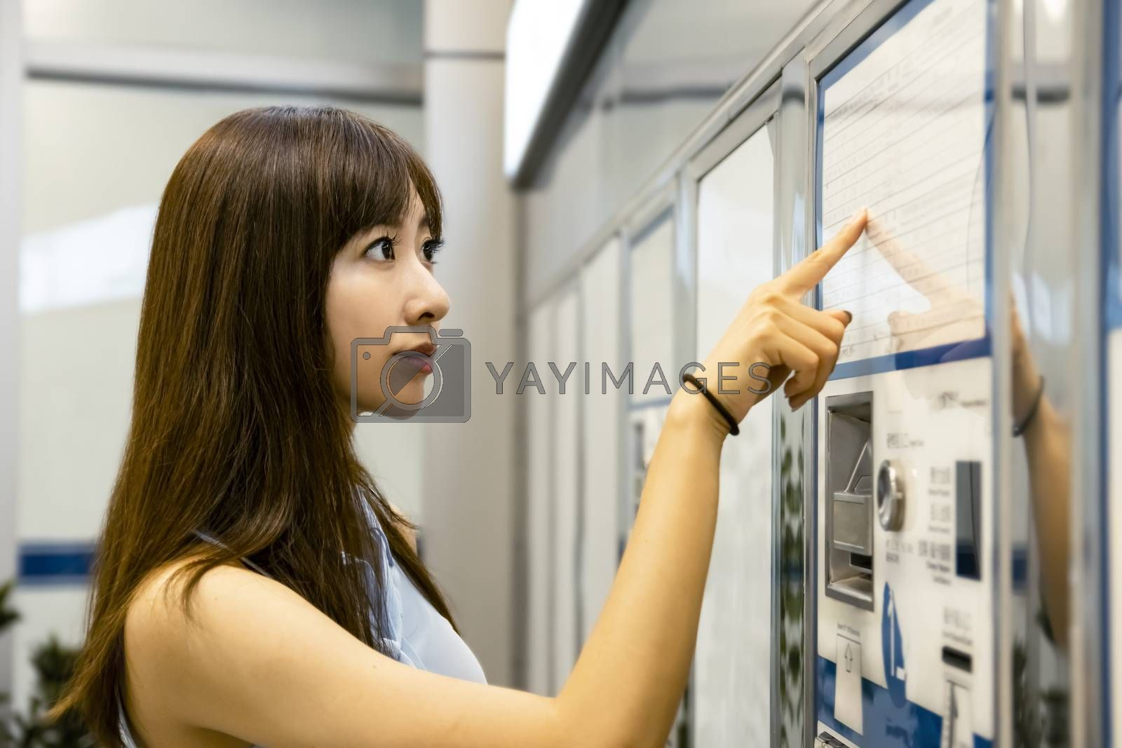 young woman buying tickets for public transportation