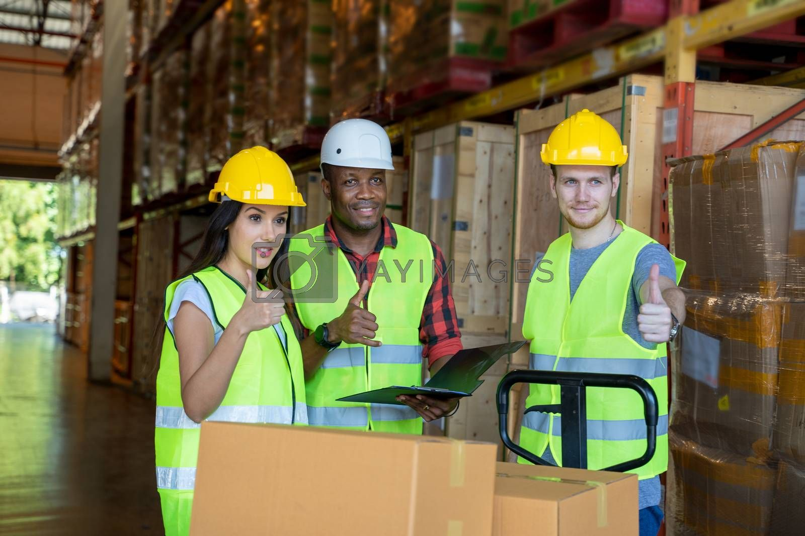 Warehouse workers team standing together in warehouse.