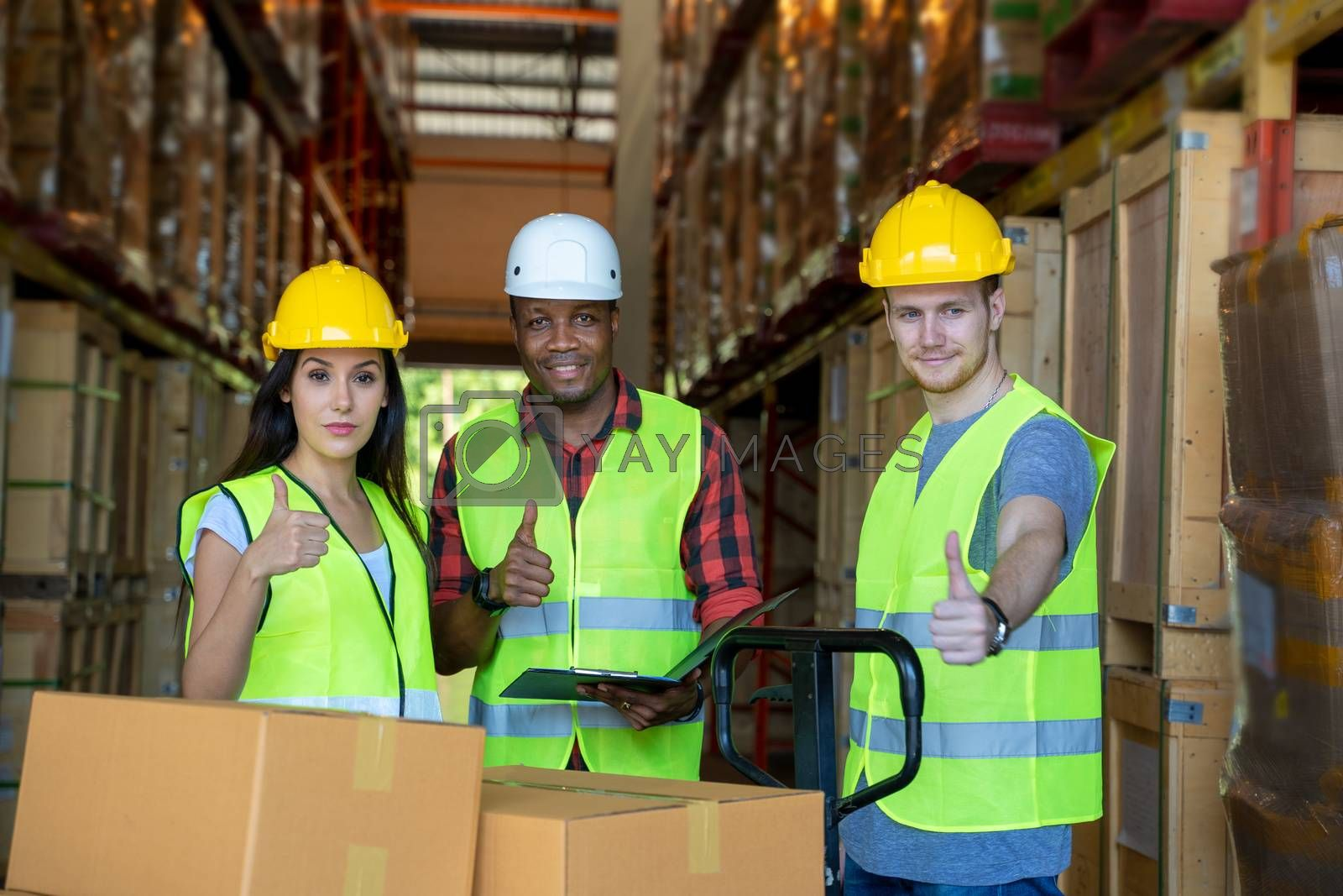 Warehouse team discussing and working with clipboards in warehouse.