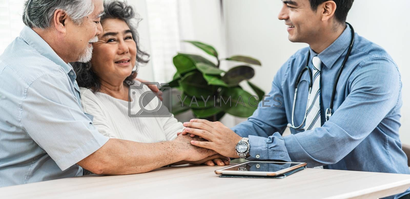 Closeup Doctor hands holding Asian grandparent patient in house by Tzido