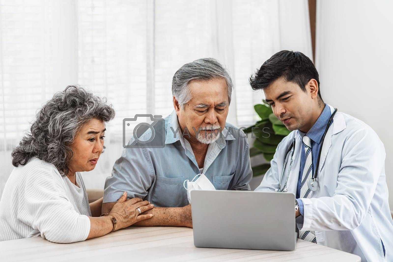 Doctor using technology laptop to explain and talking for auscultate Asian grandparent patient in house, healthcare with Long live and Elderly society, Prevent epidemic, Covid19 Disease concept